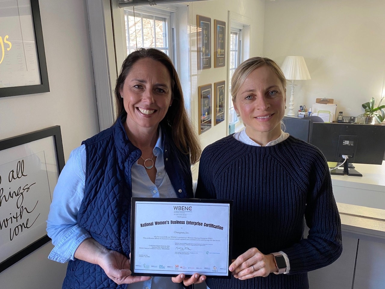 Cleangreen's Annette Contonio and Jitka Borowick hold the company's Women's Business Enterprise certificate.